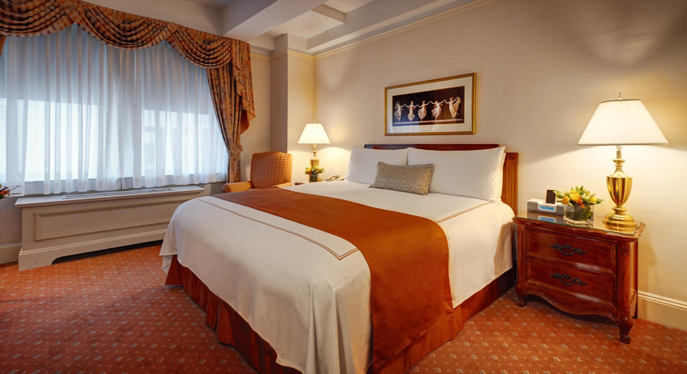 Deluxe King Room at the Hotel Elysee with 1 King Bed.  Approximately 300 square feet and comfortable for up to 2 adult guests.
