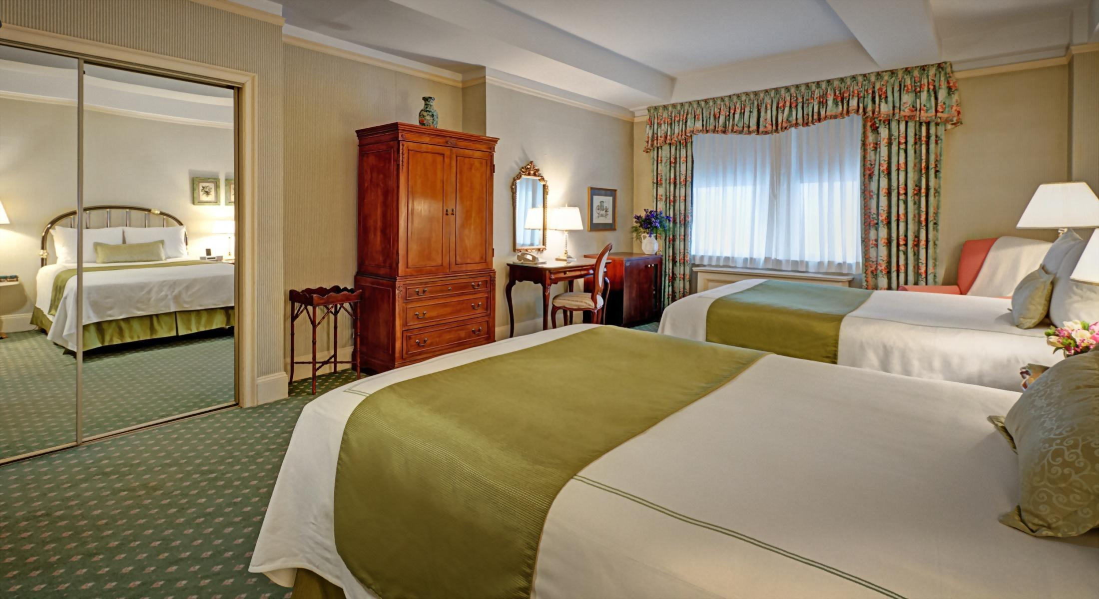 Deluxe Double Room with 2 Double Size beds at the Hotel Elysee.  Approximately 300 square feet.  Perfect for 2 adults or 1 adult and 1 child.