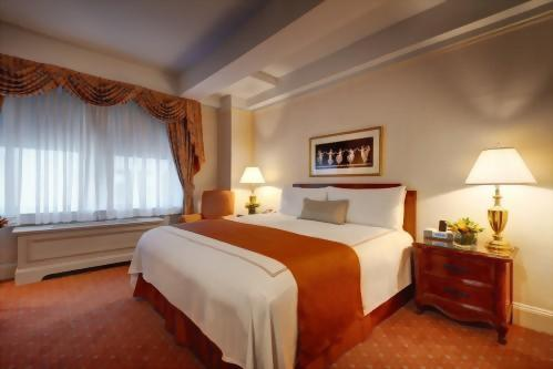 Bedroom of the King Suite at the Hotel Elysee.  This is perfect for a small family because there is a queen size sofa bed in the living room.