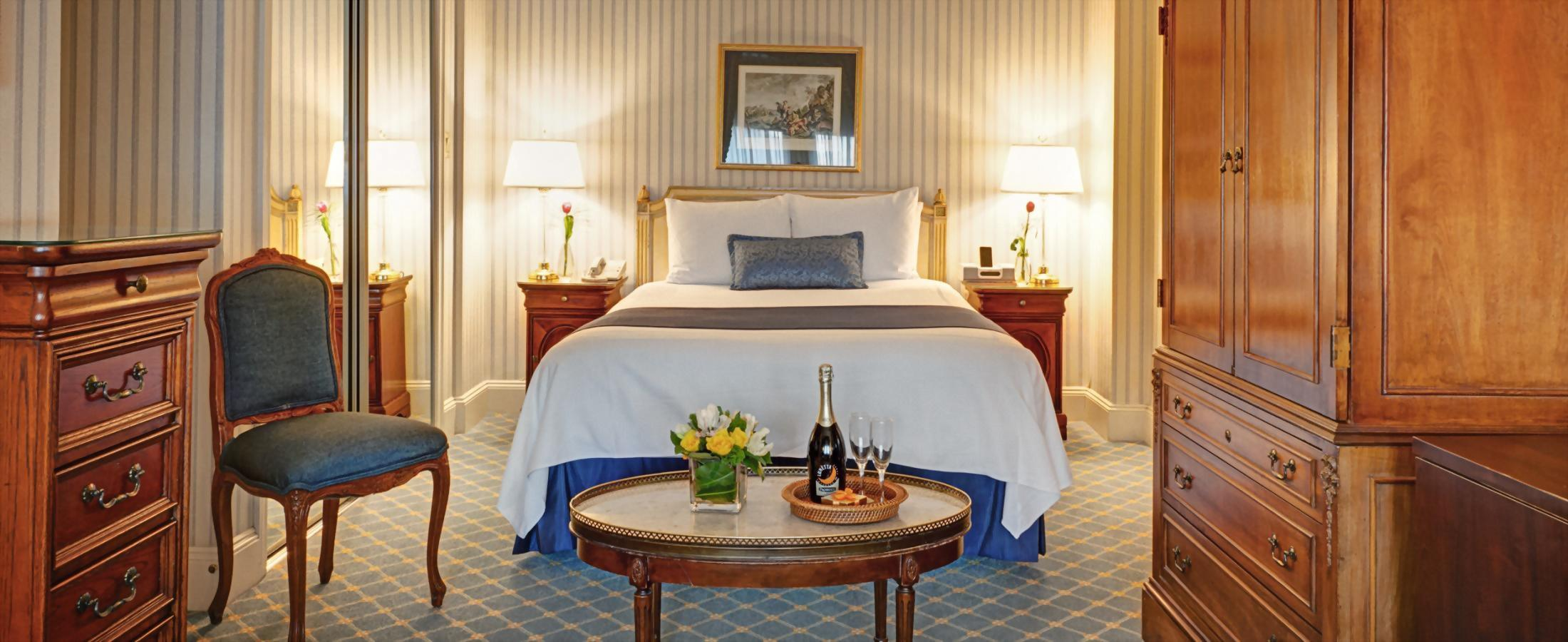 Deluxe Queen Room at Hotel Elysée has one queen bed and is approximately 300 square feet.