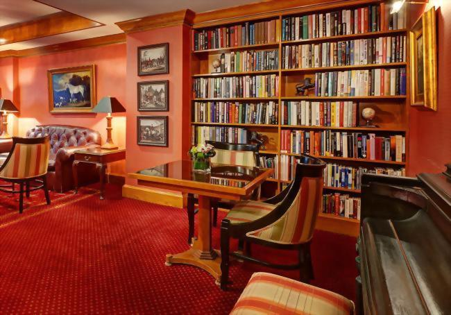 At the Hotel Elysee in New York City the library and Club Room are open all day for our guests.  We encourage our guests to enjoy coffee, tea, fruit and cookies all day.