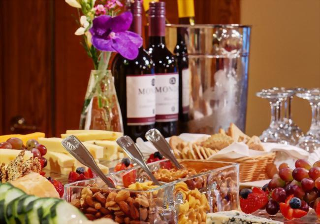 The complimentary wine & hors d'oeuvres reception at the Hotel Elysee includes an assortment of red and white wines, Prosecco, nuts, domestic and imported cheeses and crackers and crudite.