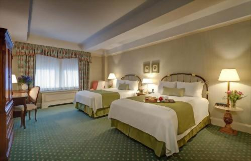 Deluxe room with 2 full sized beds at the Hotel Elysee New York by Library Hotel Collection.  Approximately 300 square feet and suitable for up to 2 adults.