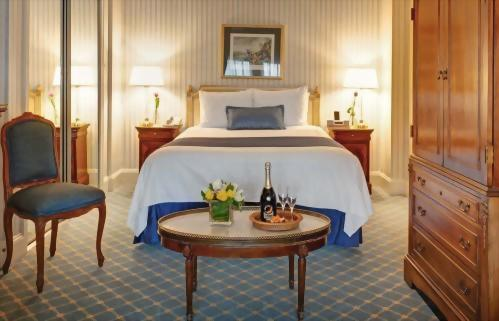 Queen Bedded Deluxe Room at Hotel Elysee New York by Library Hotel Collection.  Approximately 300 square feet.  Suitable for up to 2 adults.