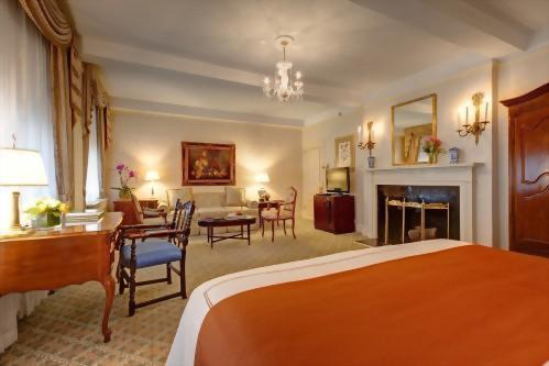 Junior Suites at the Hotel Elysee in New York City have faux fireplaces to add to the romance of your getaway.  With 450 square feet of space there is plenty of room to kick back and relax.