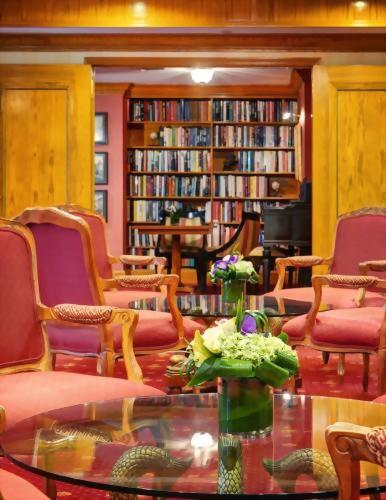 A peak into the Library at the Hotel Elysee by Library Hotel Collection.  We encourage guests to take a book or leave a book.
