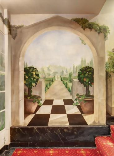 As you approach the top of the staircase in the Lobby of the Hotel Elysee you will come across beautiful murals that make you feel like you might just be in the heart of France.
