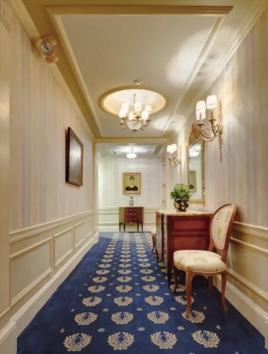 Elegant hallways of the Hotel Elysee New York by Library Hotel Collection lead to guest rooms.