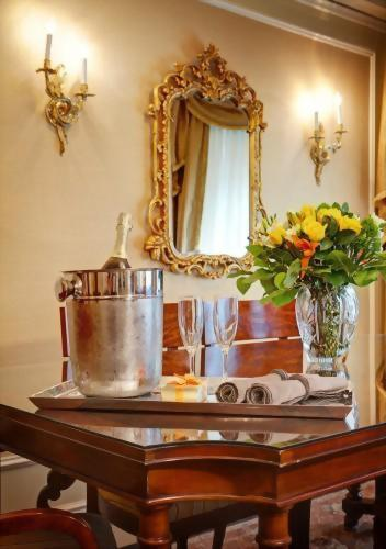 Enjoy a bottle of champagne in the dining room area of the Presidential Suite honoring Tennessee Williams.  This suite offers approximately 900 square feet of living space with a walk in closet!