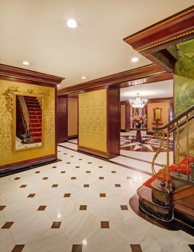 The stairs in the Lobby of the Hotel Elysee lead up to the rooms of the hotel as well as the Club Room on the 2nd floor where our guests relax and enjoy breakfast and wine & hors d'oeuvres.