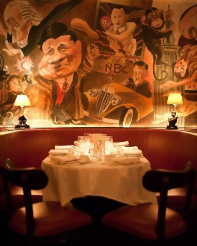 The mural on the walls of the Monkey Bar at the Hotel Elysee NYC was originally painted by Caricaturist Charlie Wala in the 1950's.
