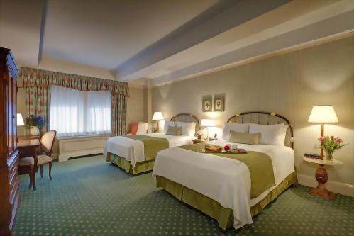 Enjoy your own bed in a deluxe double room, perfect for friends traveling together.