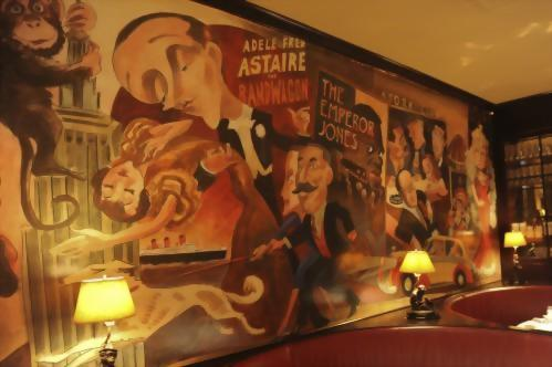 The famous mural in the Monkey Bar was painted in the early 50's by caricaturist Charlie Wala. In successive years, other artists have added to the tableau, keeping the Monkey Bar as polished as it always was in days gone by.