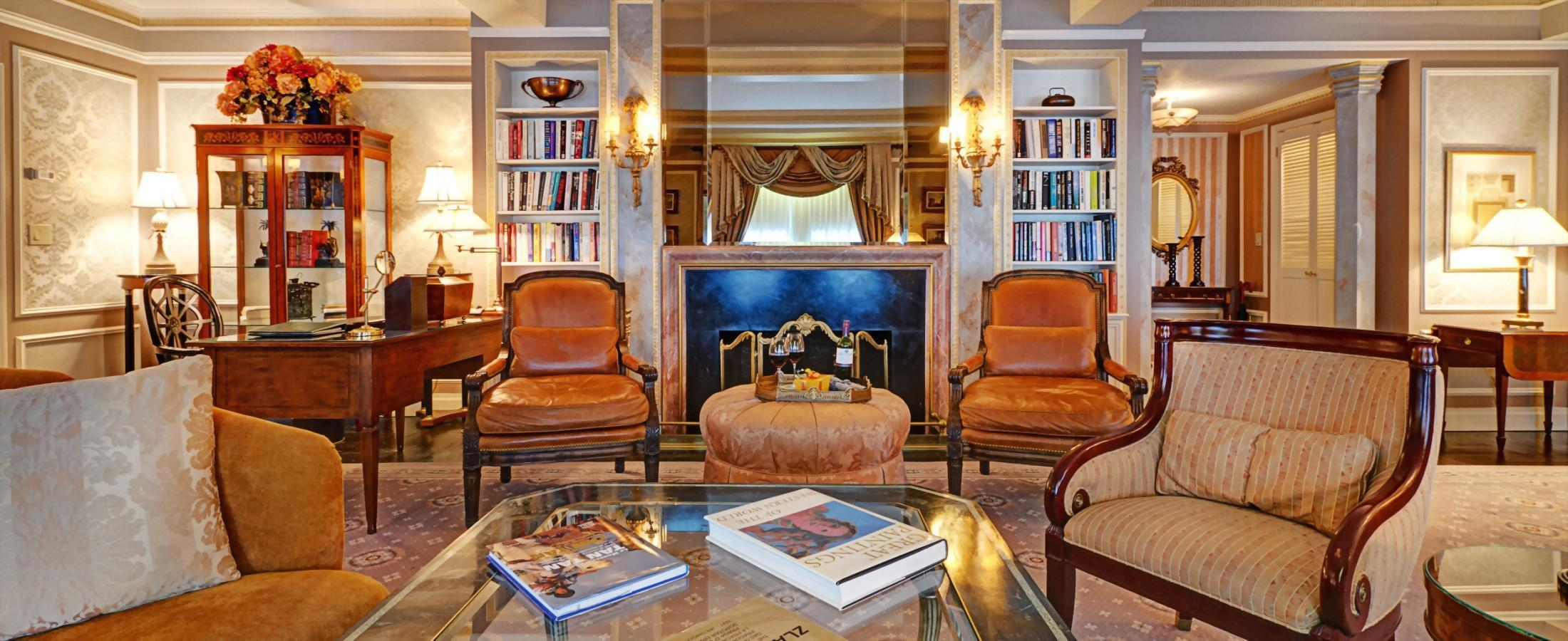 The living room of the Vaclav Havel Suite at the Hotel Elysée has a beautiful non-working fireplace.