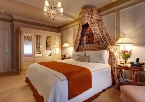 The bedroom of the Presidential Suite honoring Vaclav Havel has a spacious armoire and a king size bed.