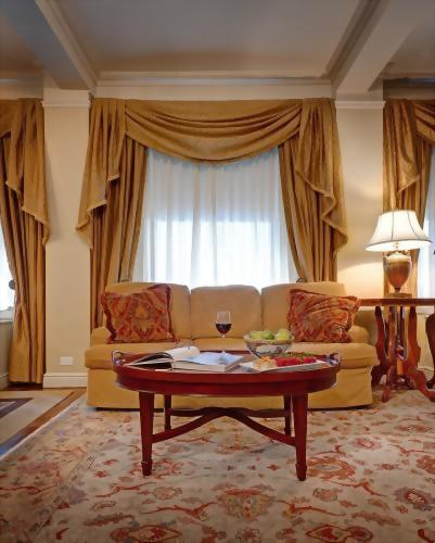 The spacious living room of the Presidential Suite honoring Tennessee Williams features a queen size sofa bed in the living room.