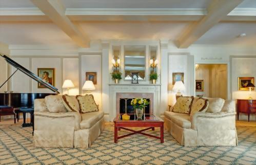 Living room of the Presidential Suite honoring Vladimir Horowitz features a faux fireplace.