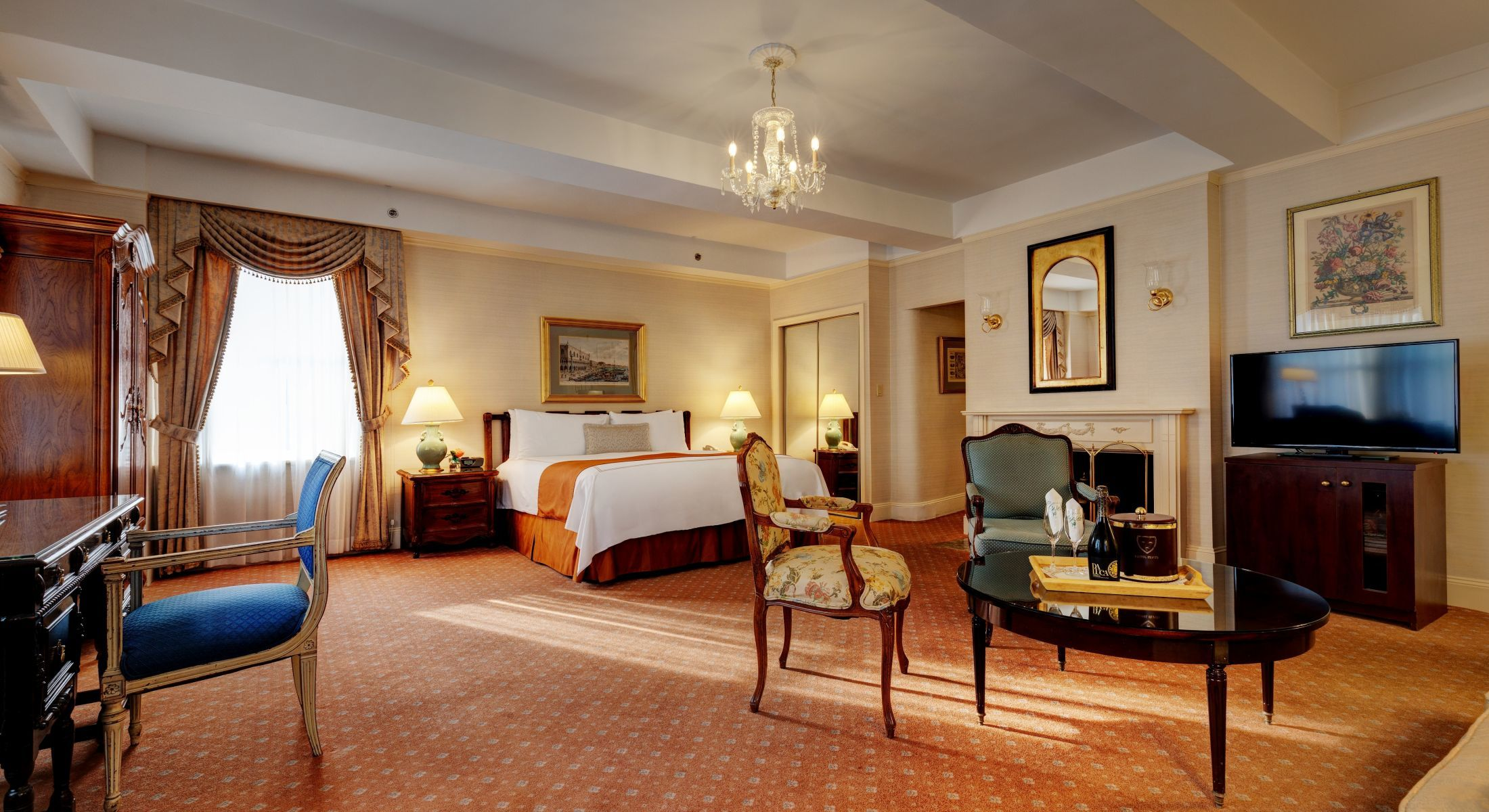 Beautiful Junior Suites at the Hotel Elysee feature faux fireplaces and two televisions