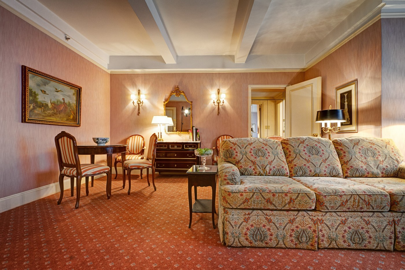 Living Room Of The Grand King Suite At The Hotel Elysee In NYC. Features A  Small Dining Table And A Kitchenette.